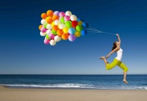 girl w: balloons on beach